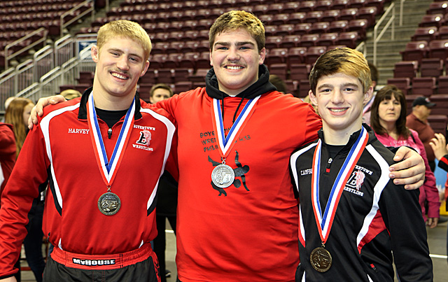 Harvey, Killoran, and Campbell pose after earn state medals