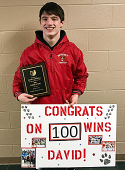D. Campbell celebrates after earning his 100th win.