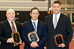 Coach Cooley, Coach Ventresca, and Coach Haley with their Hall of Fame plaques
