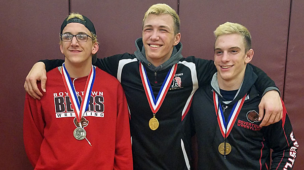 Miller, Jones, and Mortimer pose with their regional medals after qualifying for states