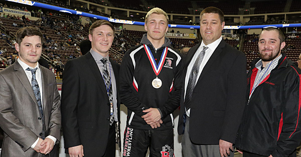 Jones poses with his 4th place state medal and his coaches